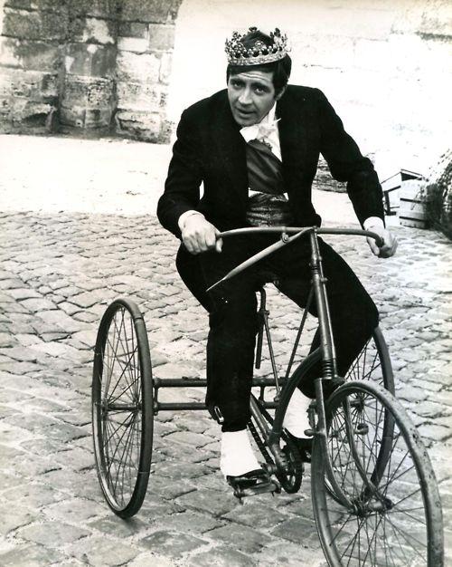 Alan Bates rides a trike