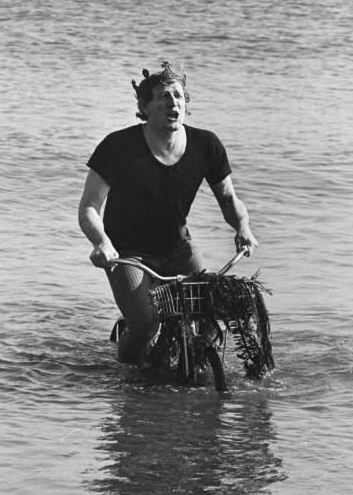 Richard Harris rides a bike. In the water. Singing