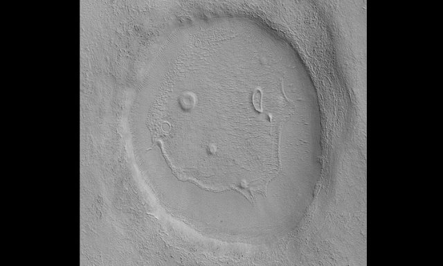 Photo taken by the Mars Reconnaissance Orbiter's Context Camera, January 2008. The unnamed crater is about 3 km across. (via NASA)