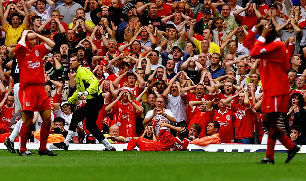 Michael Owen, his Liverpool teammates and the crowd holding their heads after Manchester United goalkeeper Massimo Taibi saved a shot during a 1999 match between the two rivals (Phil Noble/PA Archive/Press Association Images)